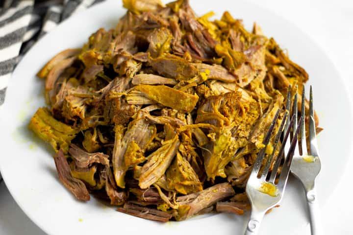 Close up shot of shredded braised curried pork roast