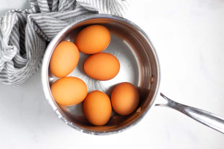 Small saucepan filled with eggs and water