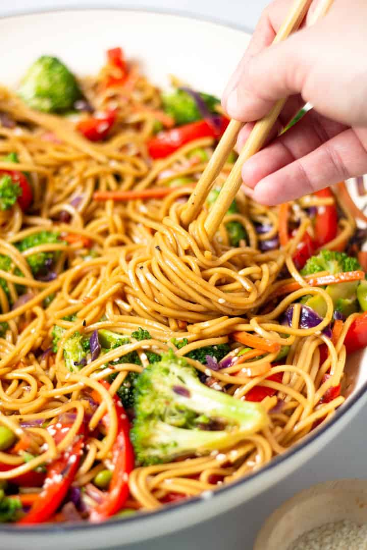 Close up shot of veggie lo mein garnished with sesame seeds