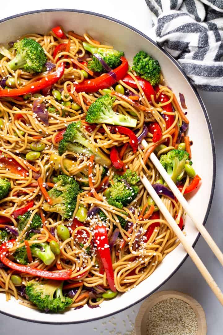 Close up shot of veggie lo mein garnished with sesame seeds