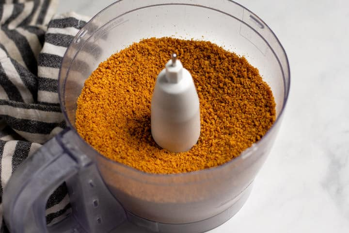 Food processor filled with gingersnap cookie crumbs