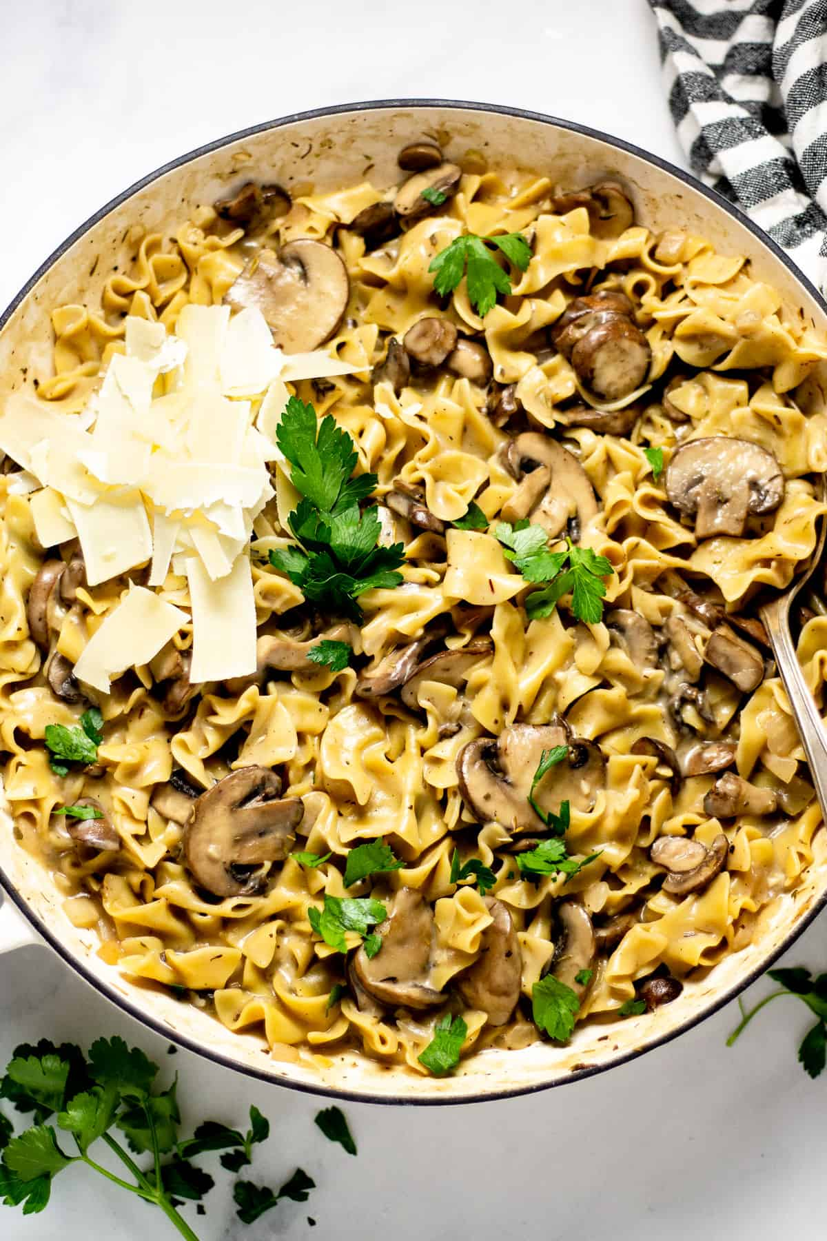 Overhead shot of a the finished dish one pot mushroom stroganoff garnished with fresh parsley and Parmesan