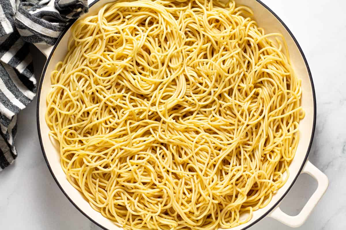 Large white pan filled with cooked spaghetti