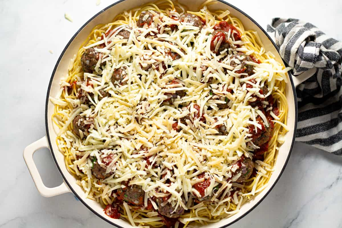 Large white pan filled with baked spaghetti casserole