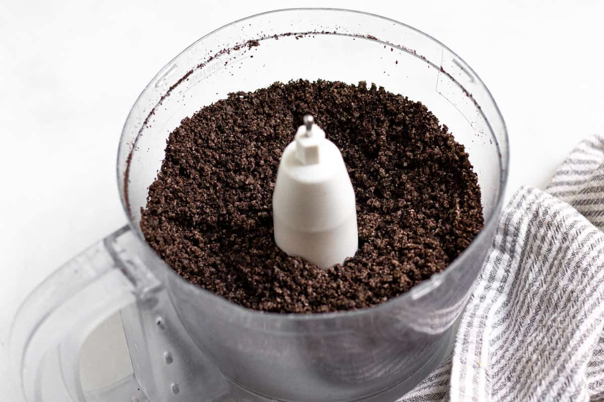 Food processor filled with oreo crumbs