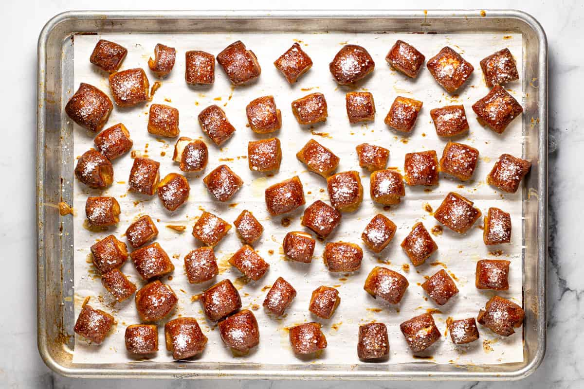 Fresh baked pretzel bites on a parchment lined baking sheet