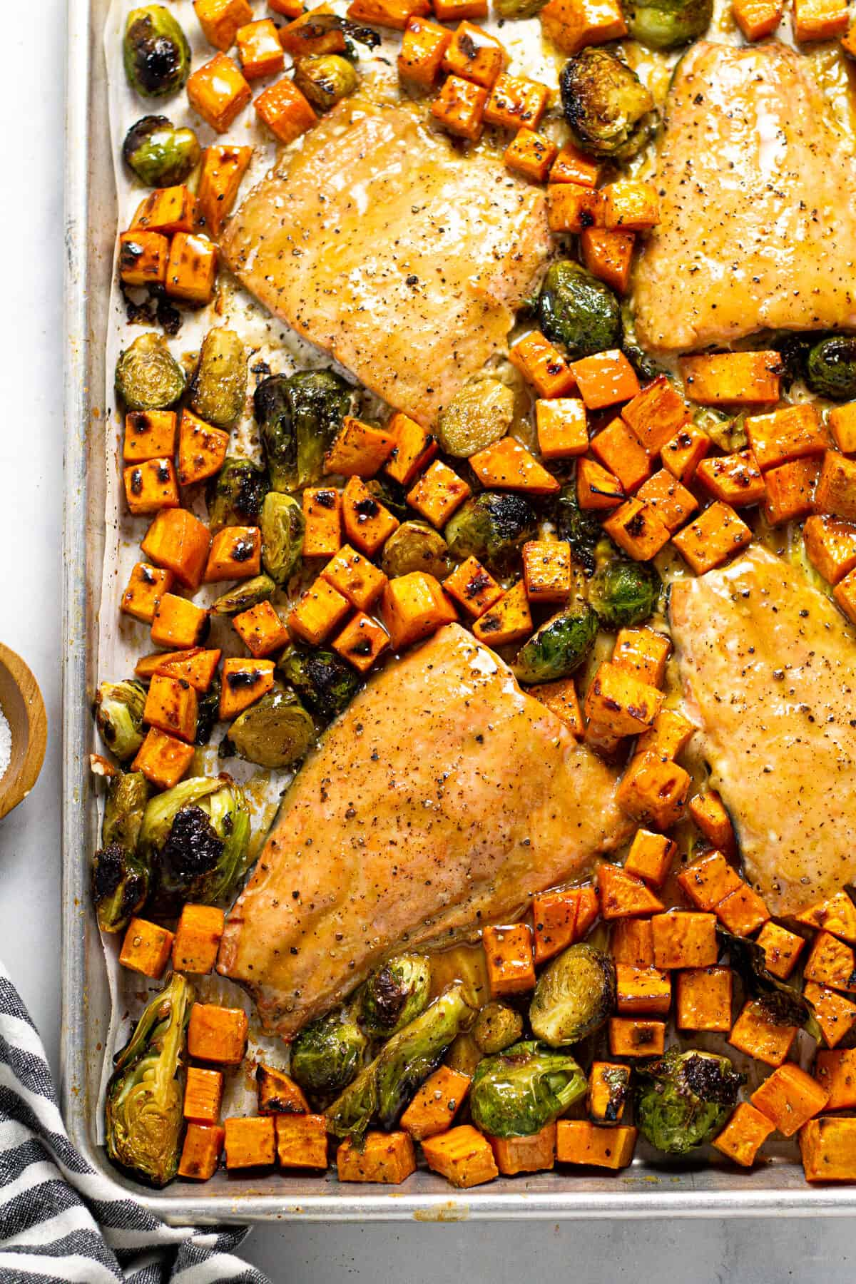Overhead shot of a sheet pan filled with maple mustard salmon and veggies