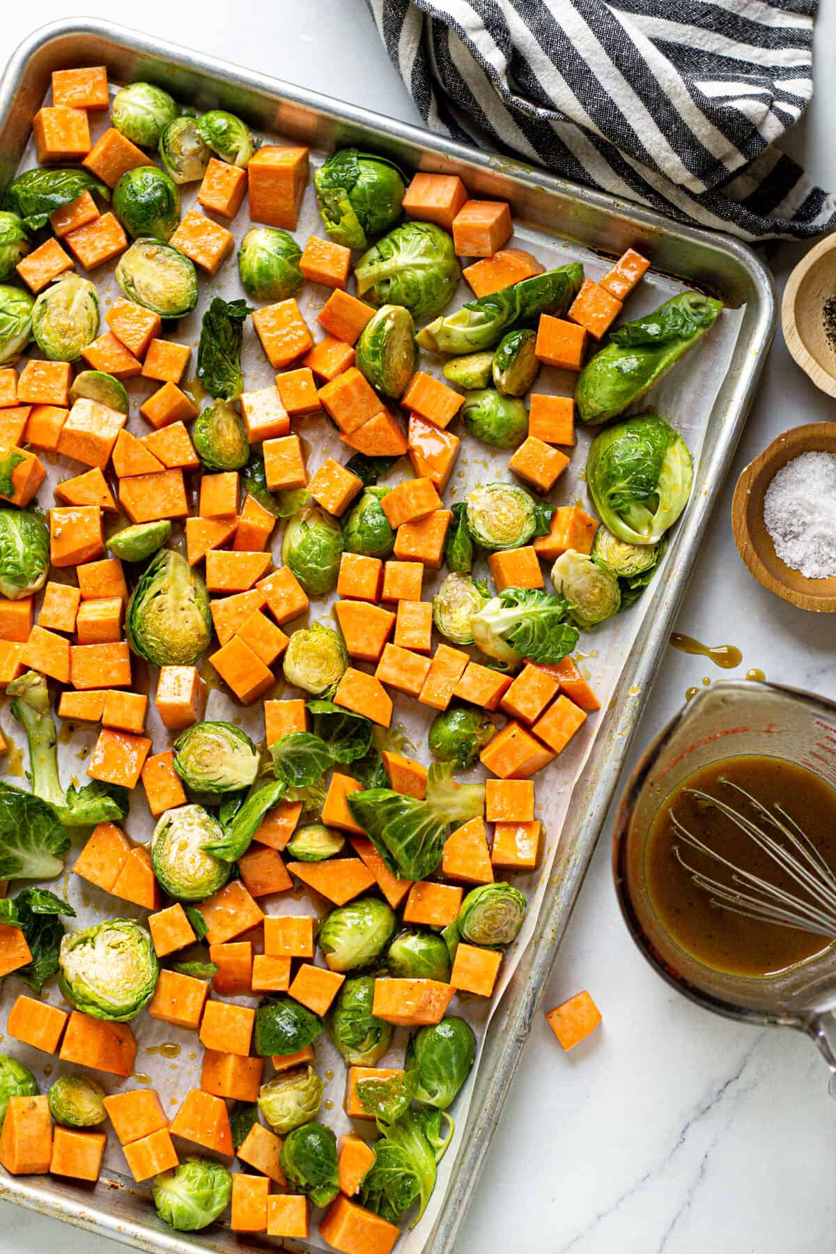 A sheet pan of Brussels sprouts and cubed sweet potatoes