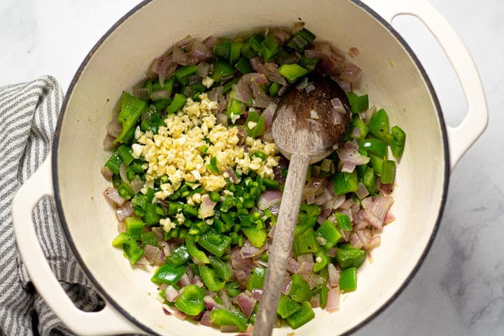 Large white pot filled with veggies for black bean soup
