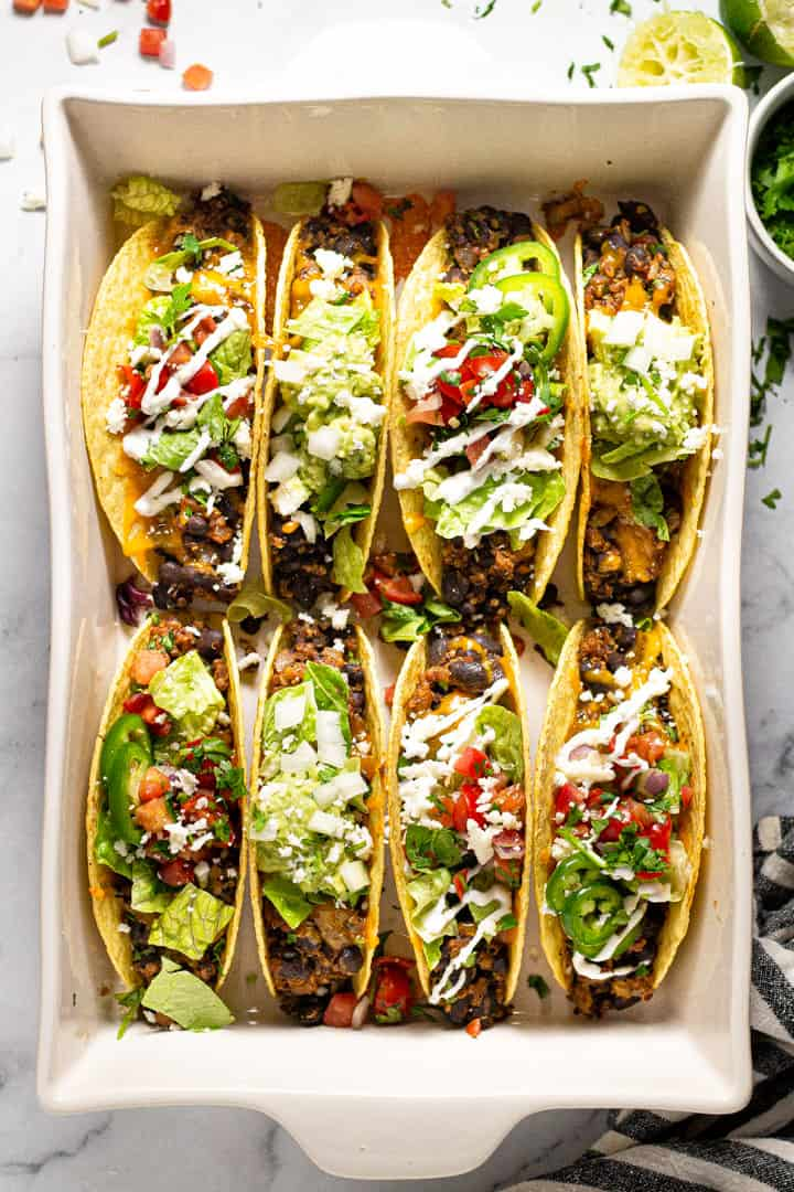 Overhead shot of a 9x13 pan filled with baked black tacos