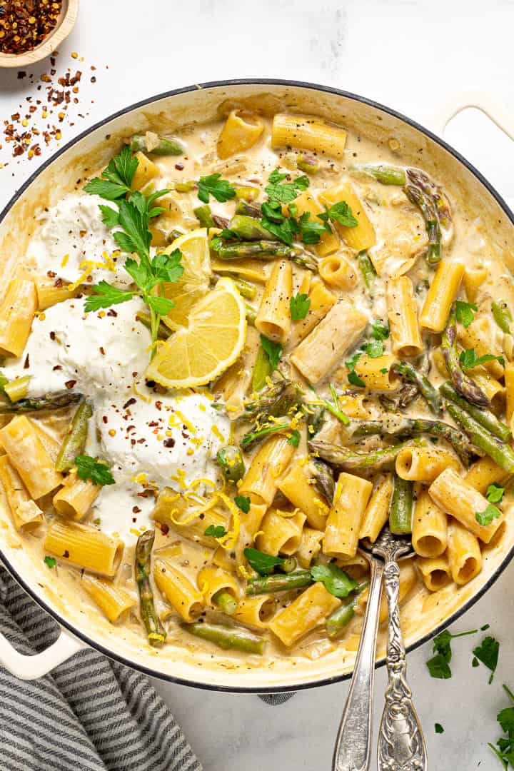 Overhead shot of a large pot filled with lemon garlic rigatoni and garnished with parsley
