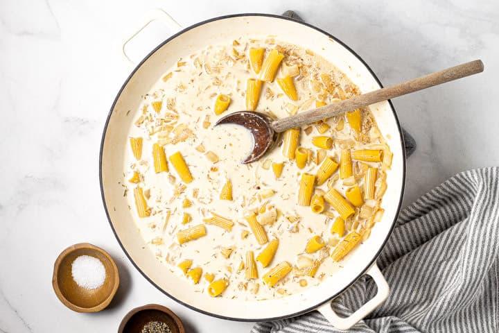 Large white pot with one pot rigatoni pasta