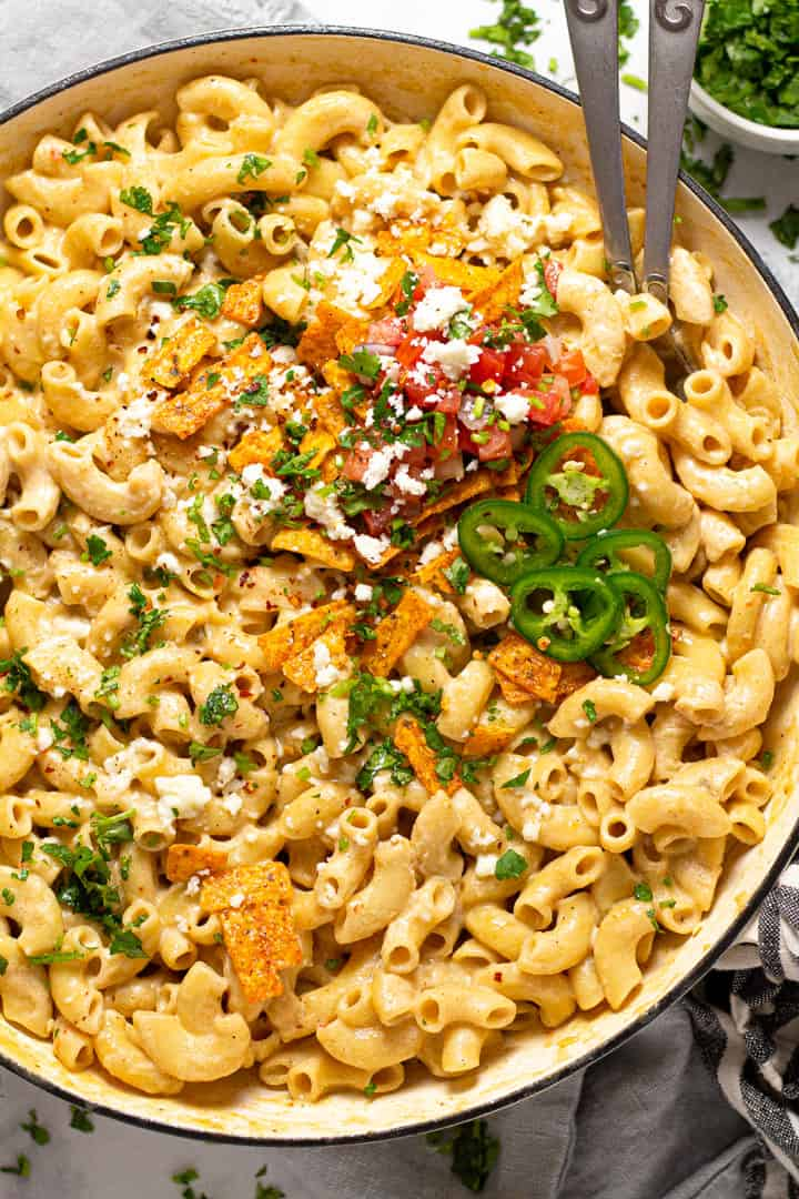 Overhead shot of a large pan filled with Mexican mac and cheese garnished with fresh cilantro