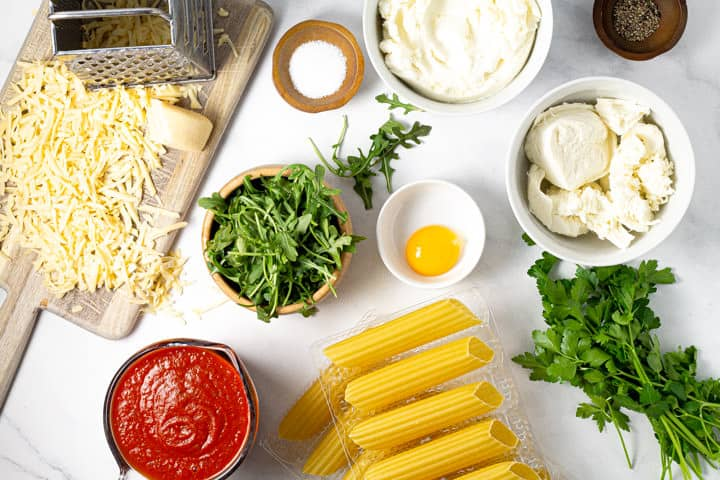 Overhead shot of ingredients needed for baked manicotti