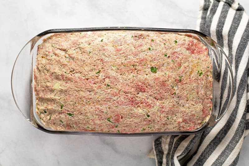 Glass loaf pan filled with meatloaf