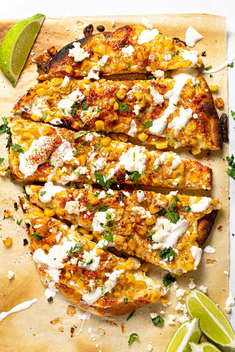 Overhead shot of Mexican street corn pizza garnished with fresh chopped cilantro