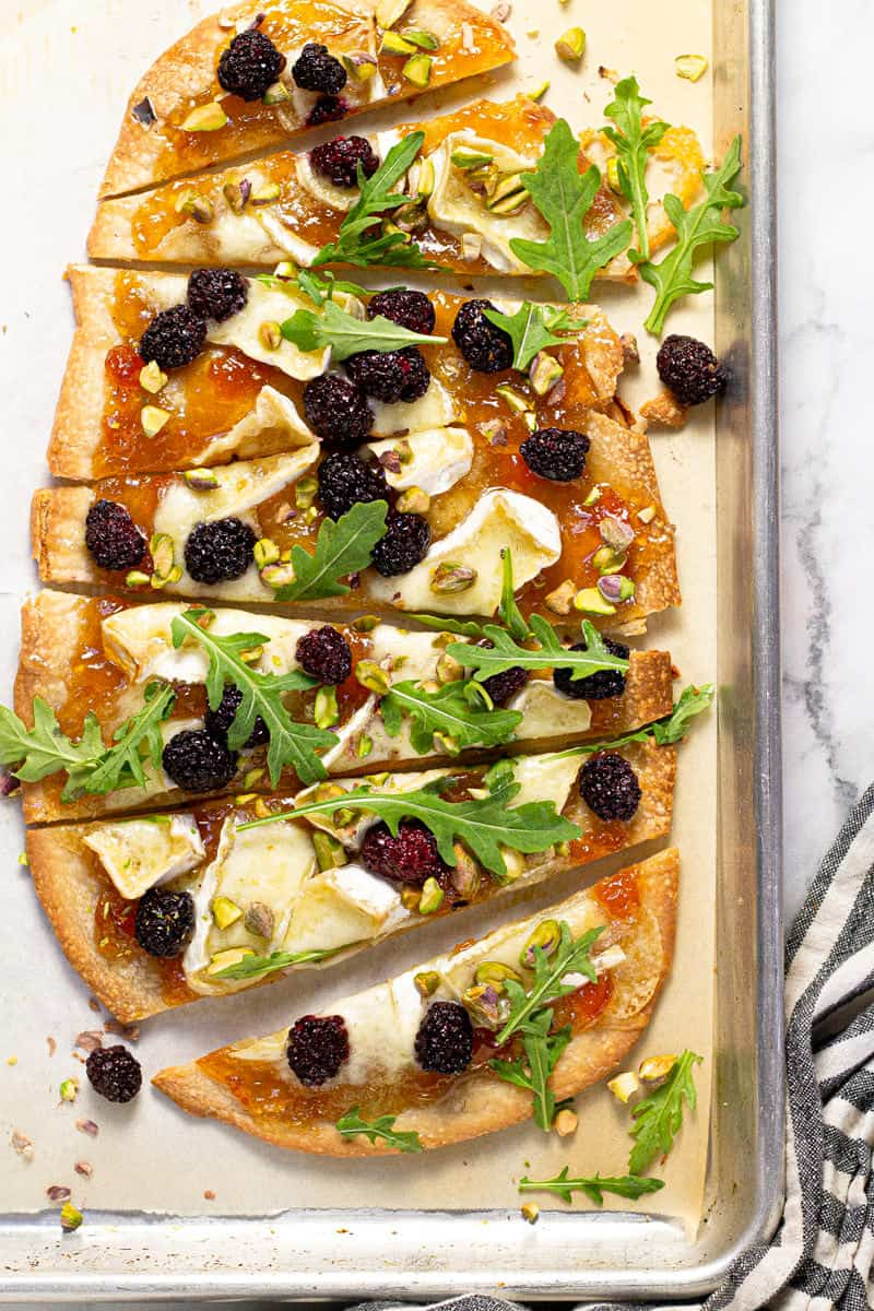 Brie blackberry flatbread on a parchment lined baking sheet