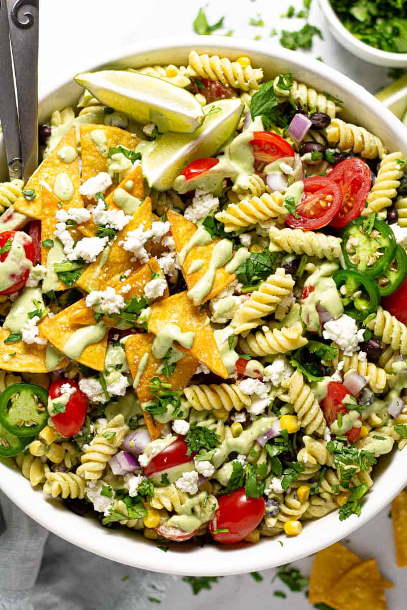 Overhead shot of a pasta salad garnished with cotija cheese and chopped cilantro