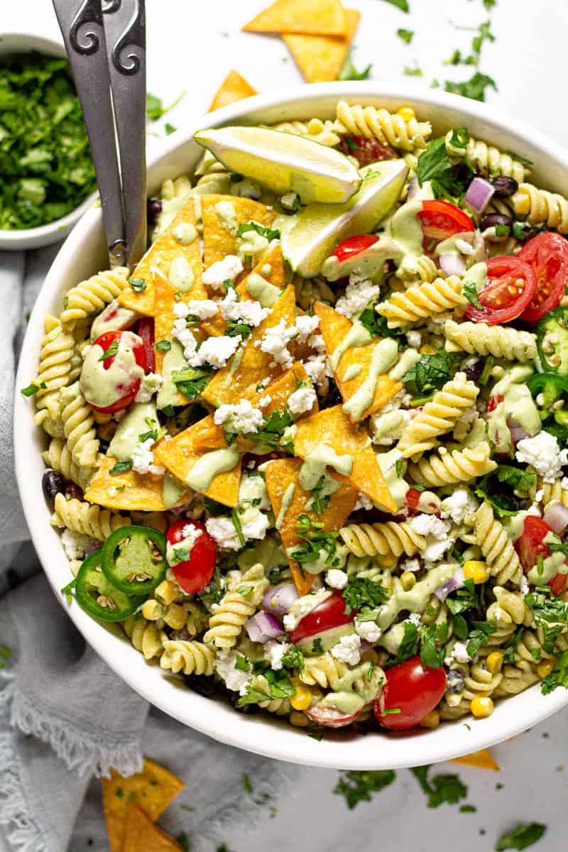 Overhead shot of a Southwest pasta salad garnished with cotija cheese and chopped cilantro