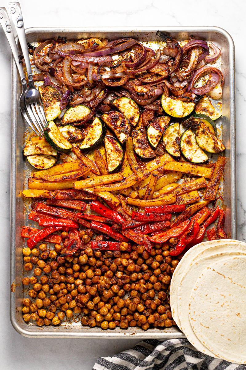 Large baking sheet with roasted chickpea fajitas