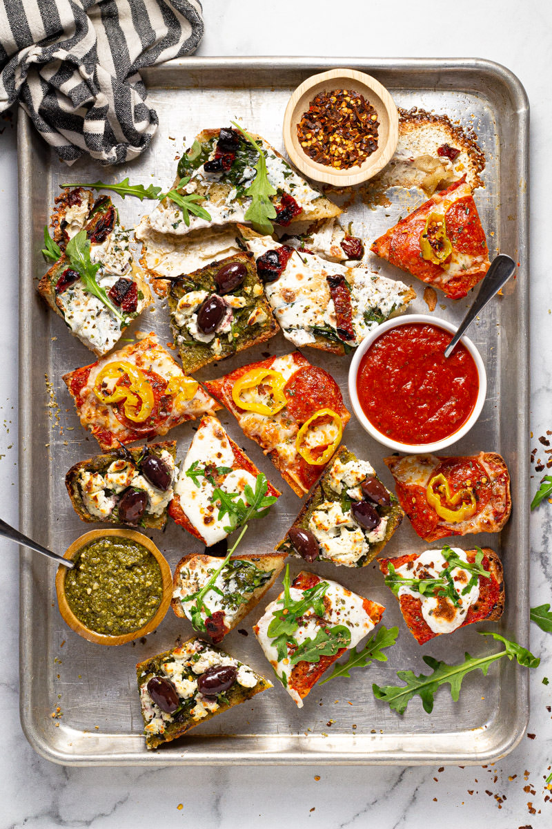Baking sheet with freshly baked slices of French bread pizza