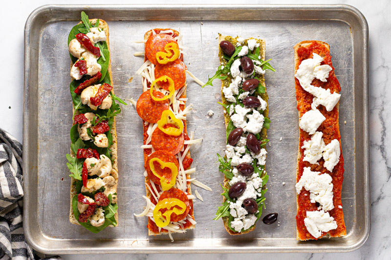 French bread pizza topped with sauce cheese and veggies