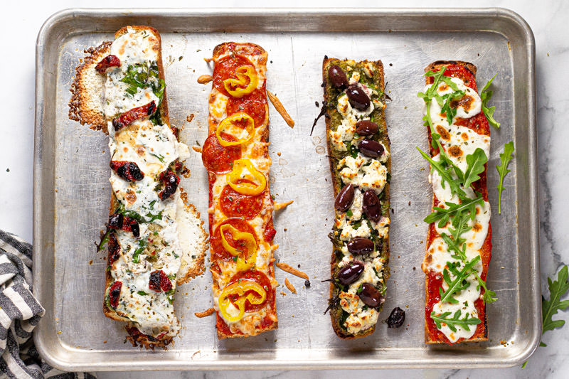Freshly baked French bread pizza on a baking sheet