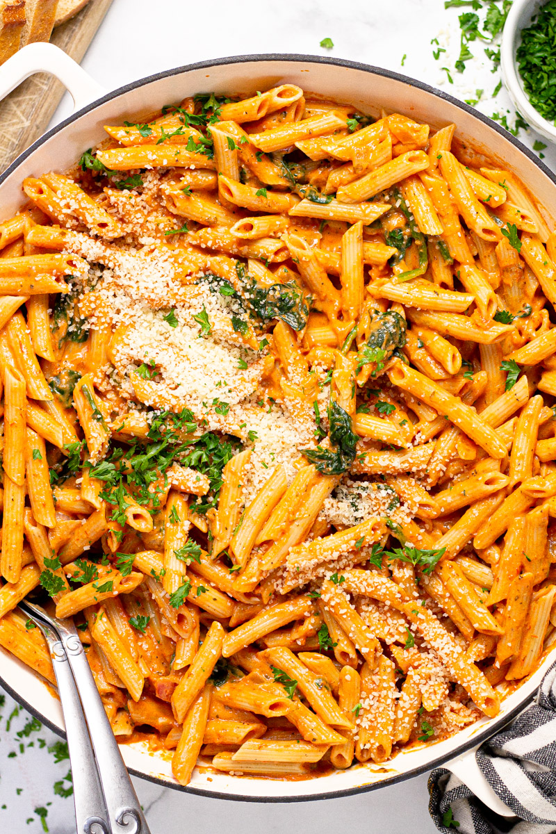 Large white pan with homemade penne rosa garnished with fresh parsley
