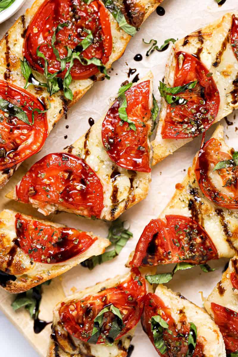 Freshly sliced Caprese garlic bread drizzled with balsamic glaze