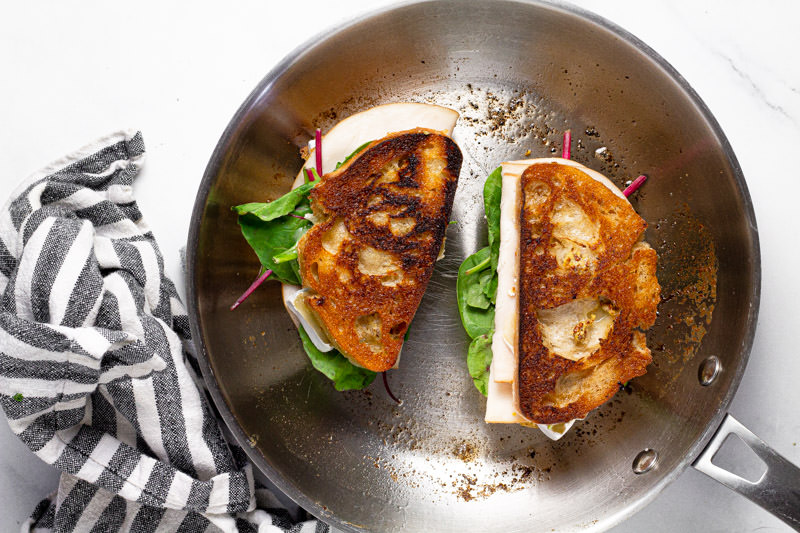 Large metal pan with turkey and Brie grilled cheese