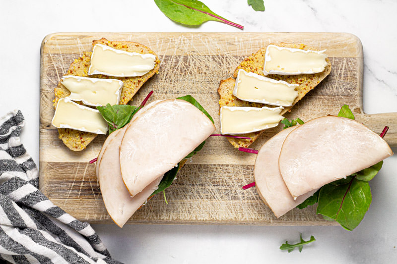 Photo showing how to assemble turkey and Brie grilled cheese