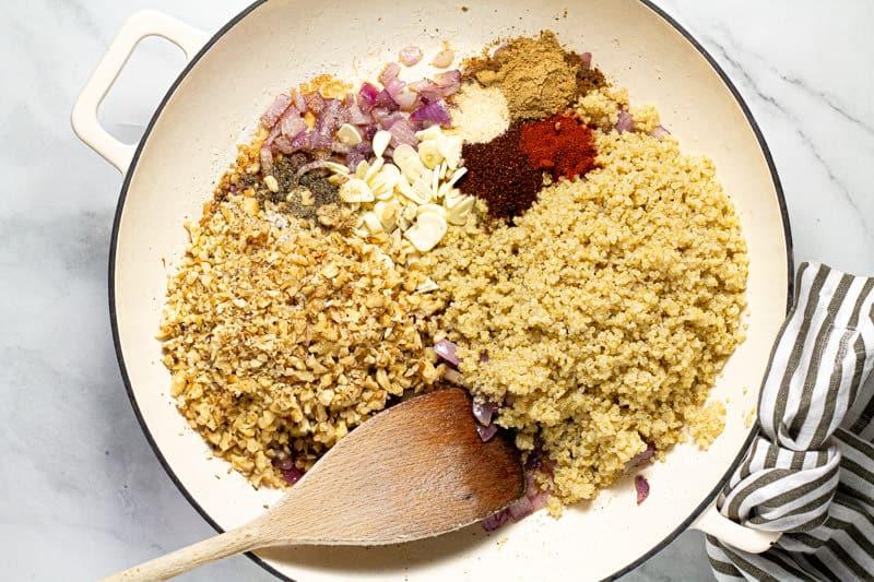 Large white pan with ingredients to make vegan taco filling
