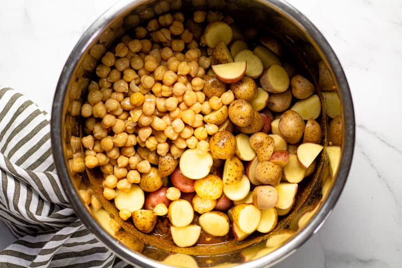 Instant pot insert with chickpeas and potatoes in it