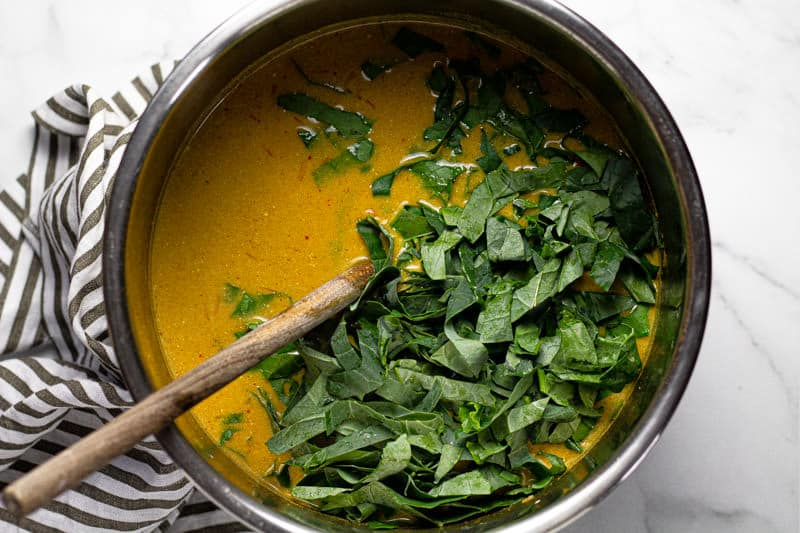 Fresh chopped spinach in a vegan instant pot curry