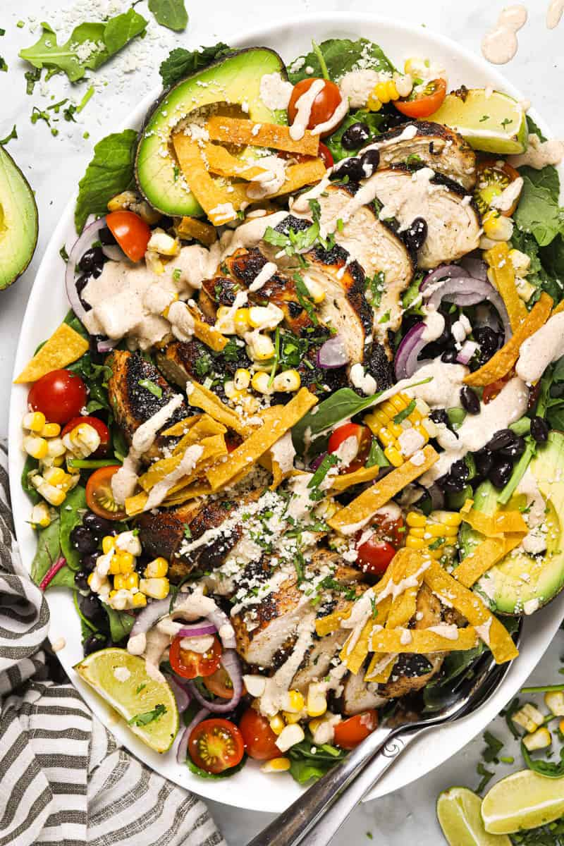 Large white platter with ingredients for making the easy Southwest salad recipe
