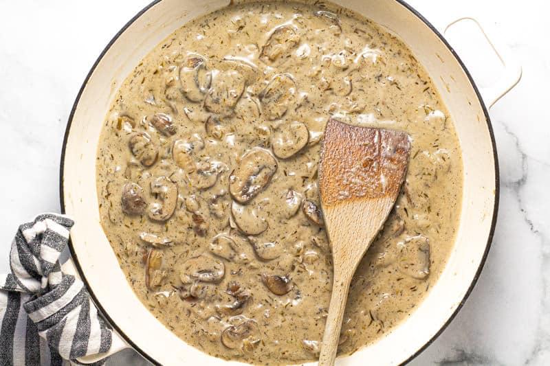 Large white pan with creamy vegan mushroom stroganoff in it