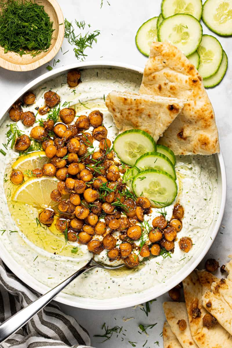 Overhead shot of a white bowl filled with whipped feta topped with chickpeas