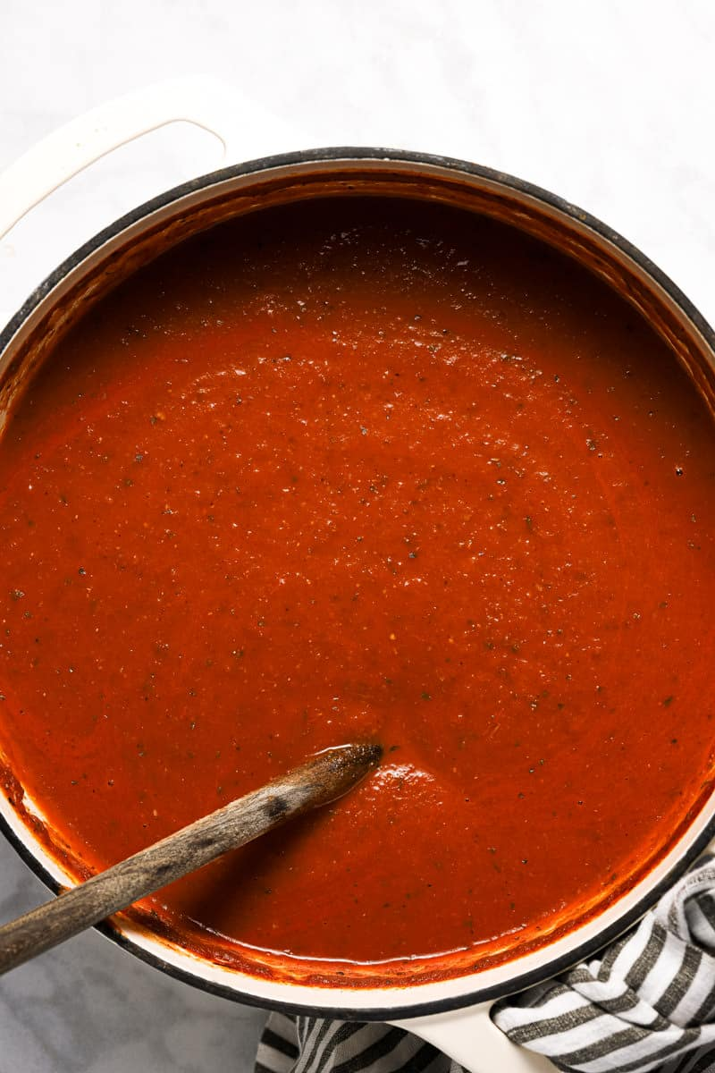 Large white pot with ingredients to make homemade tomato basil soup