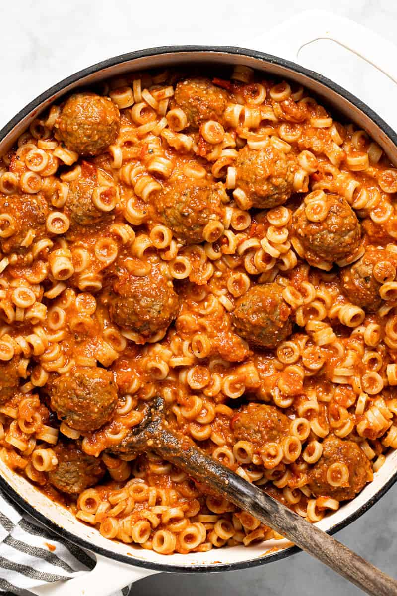 Large white pot filled with homemade spaghettios and meatballs