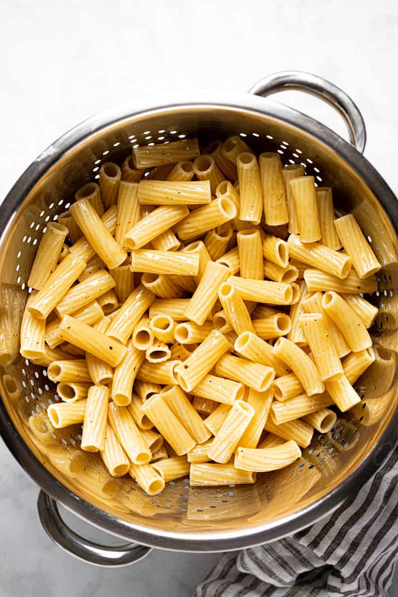 Metal strainer filled with al dente rigatoni