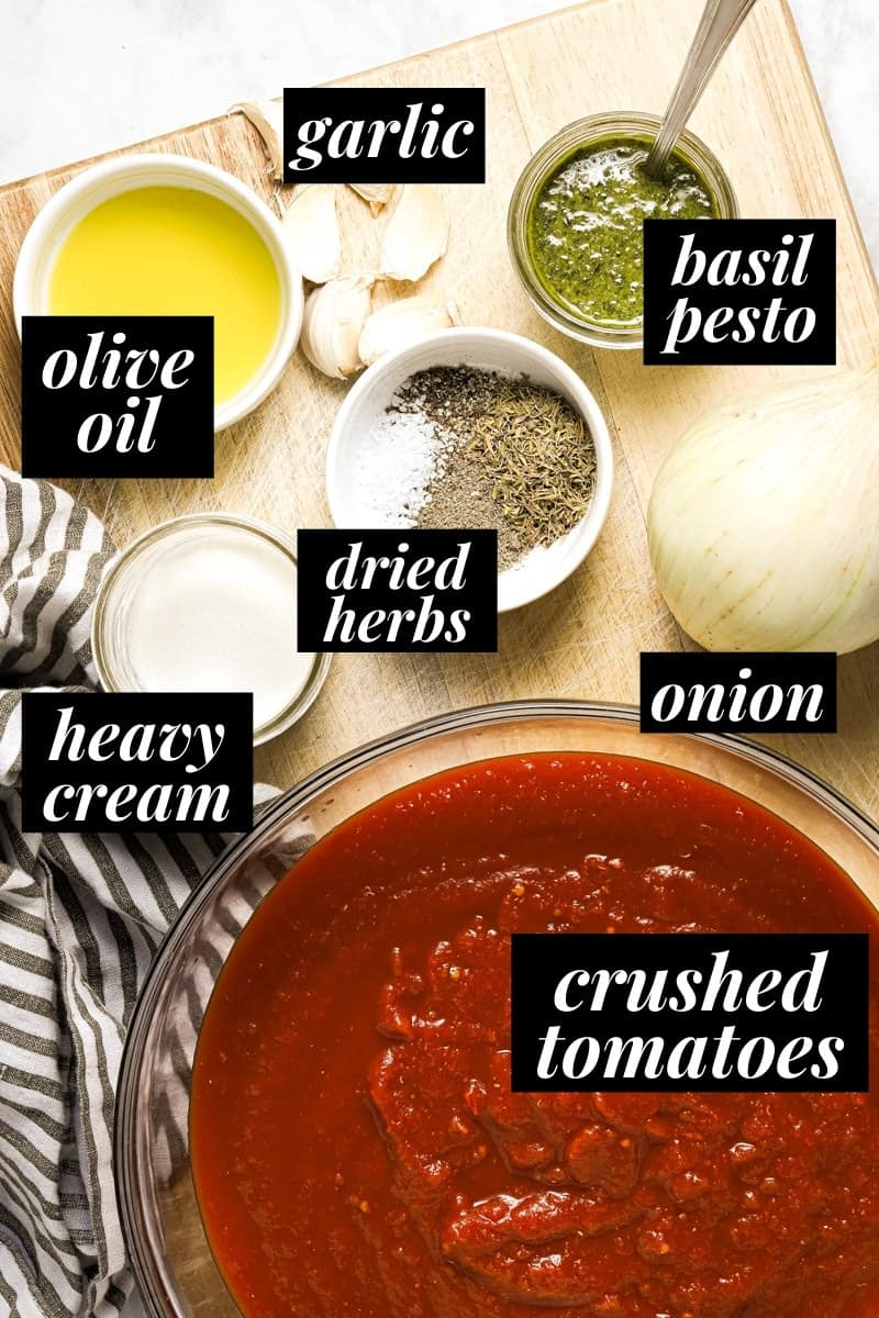 Overhead shot of the ingredients used to make creamy tomato basil soup
