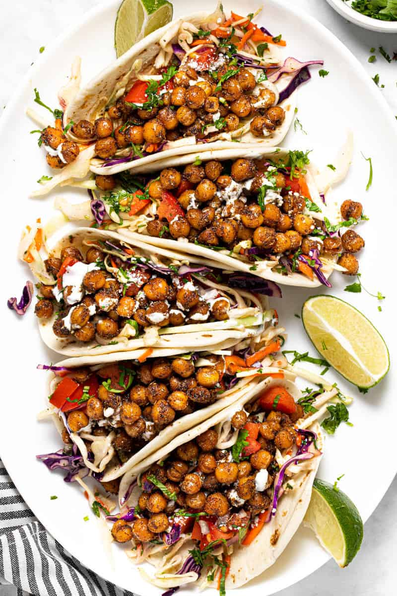 Large white platter with homemade chickpea tacos with slaw