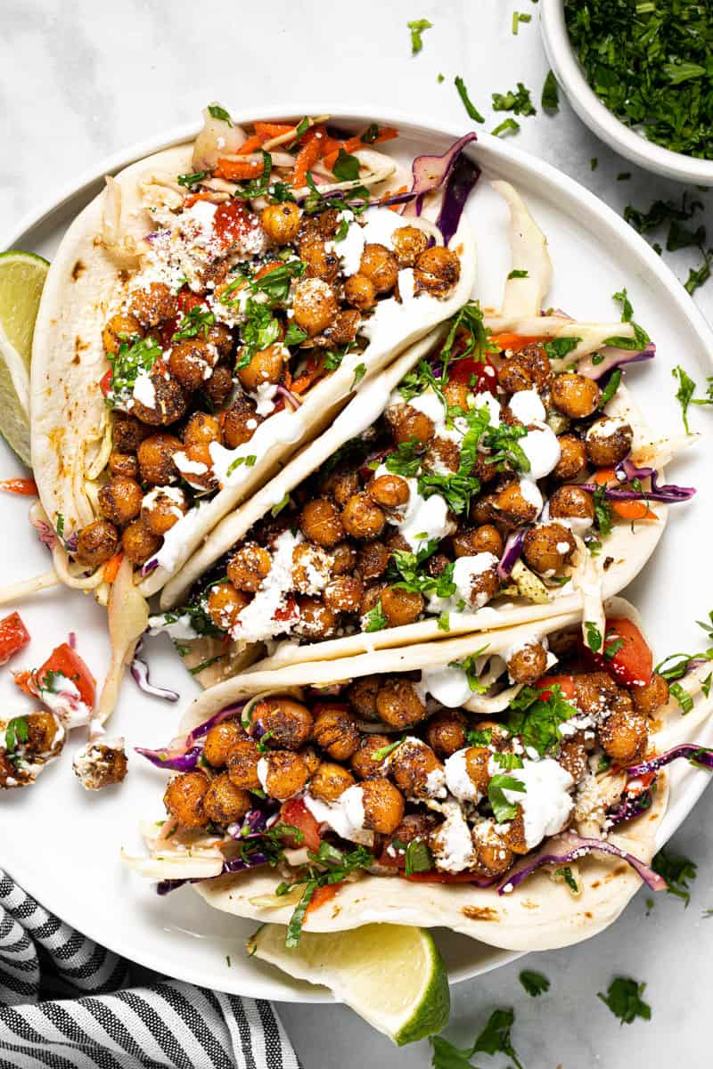 White plate with homemade chickpea tacos with slaw