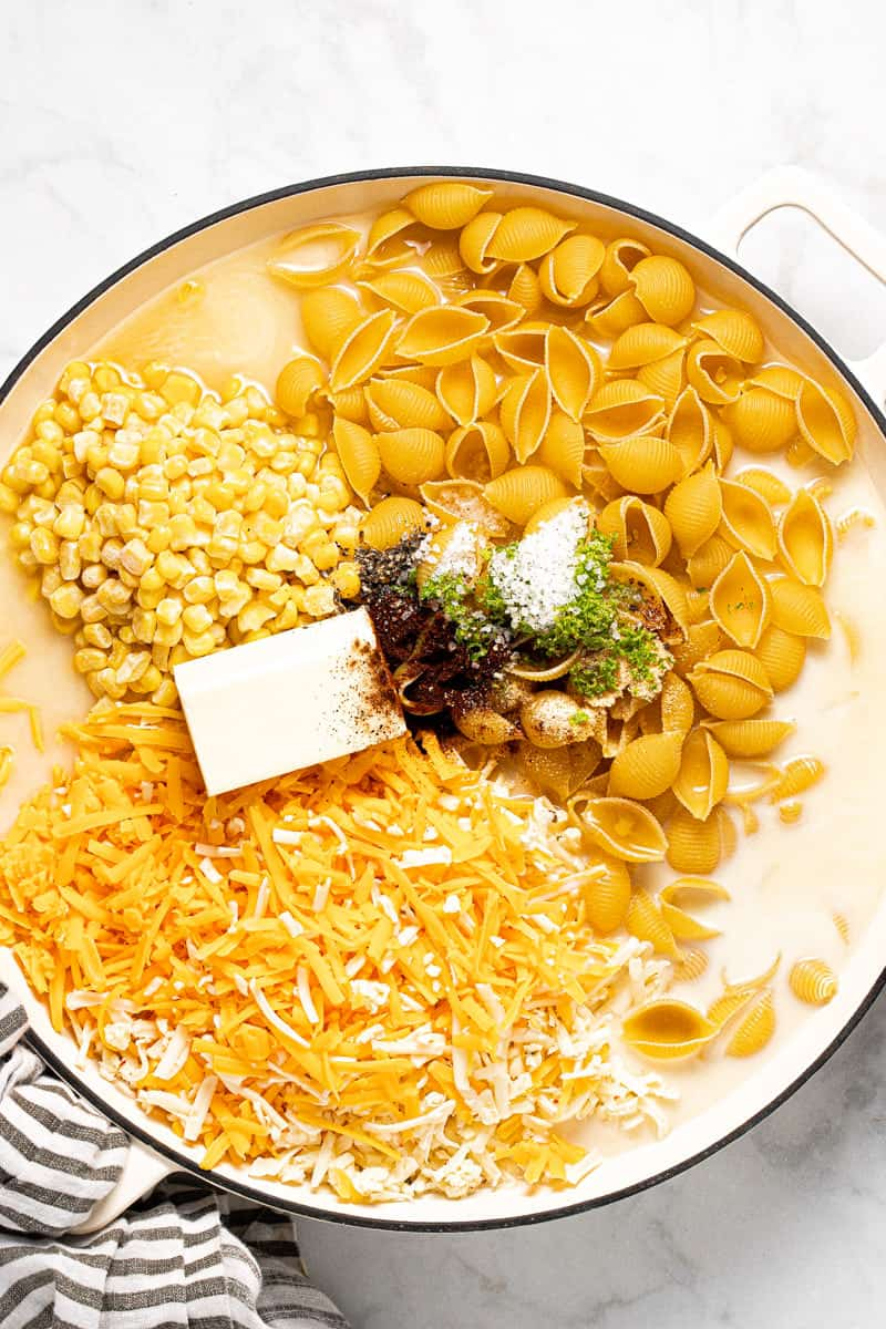 Large white pan filled with ingredients to make one pot mac and cheese