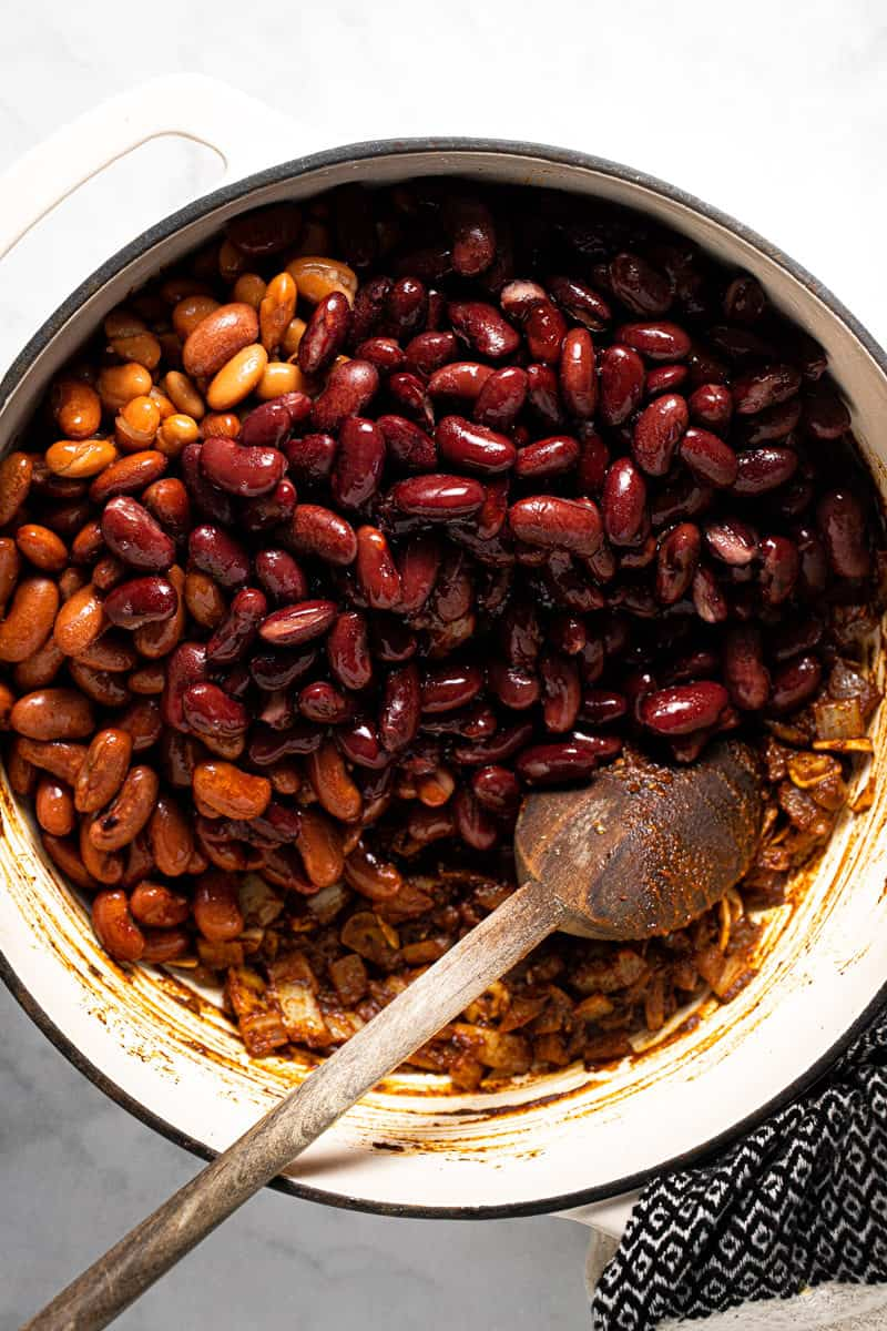 Large pot filled with ingredients to make 3 bean vegan chili