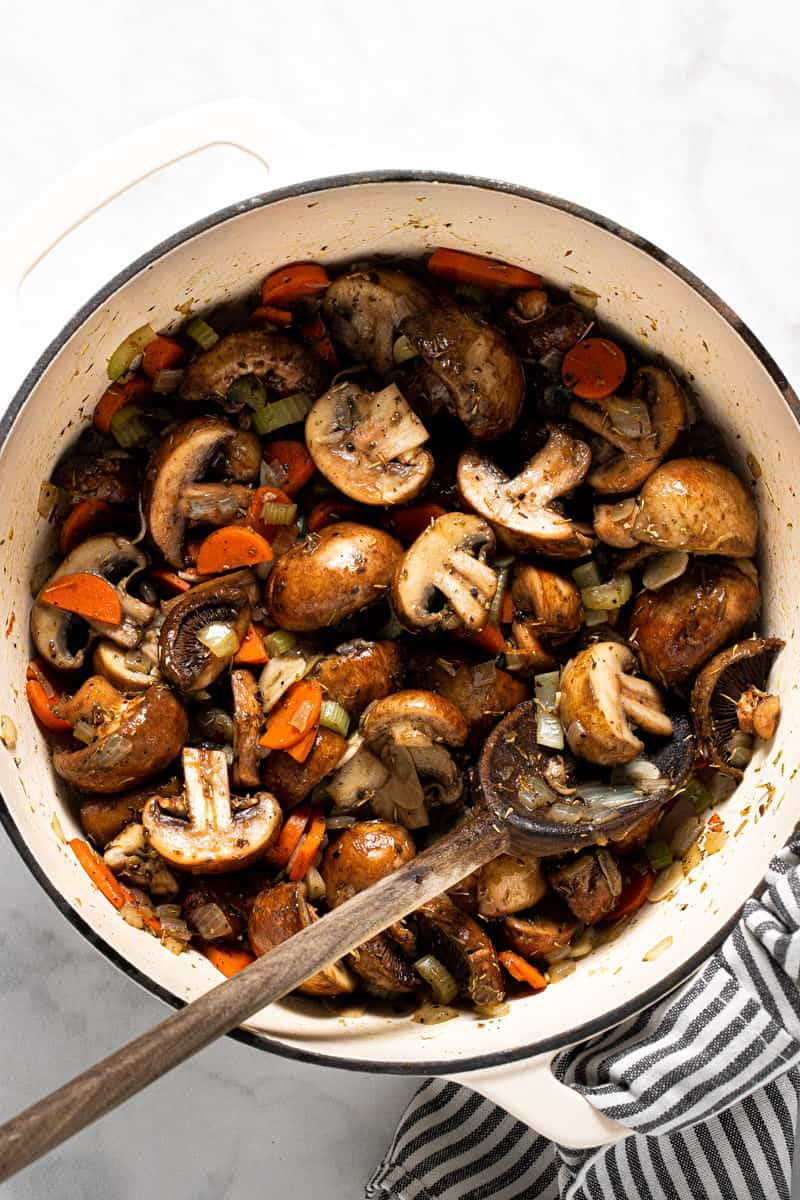 Large white pot filled with ingredients to make easy vegan stew