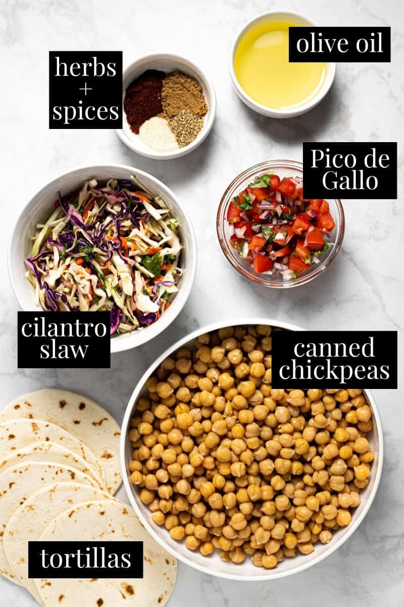 White marble counter top with ingredients to make vegan chickpea tacos