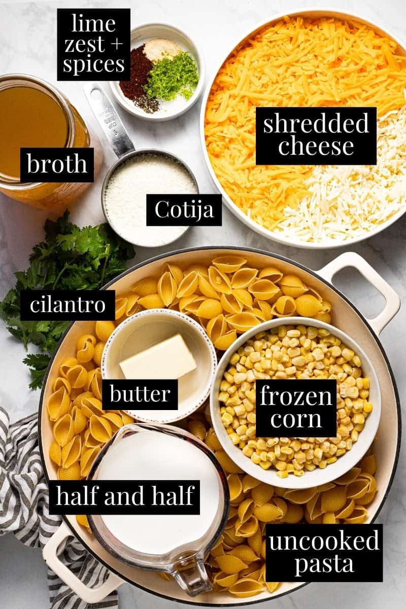 White marble counter top filled with ingredients to make Mexican street corn mac and cheese