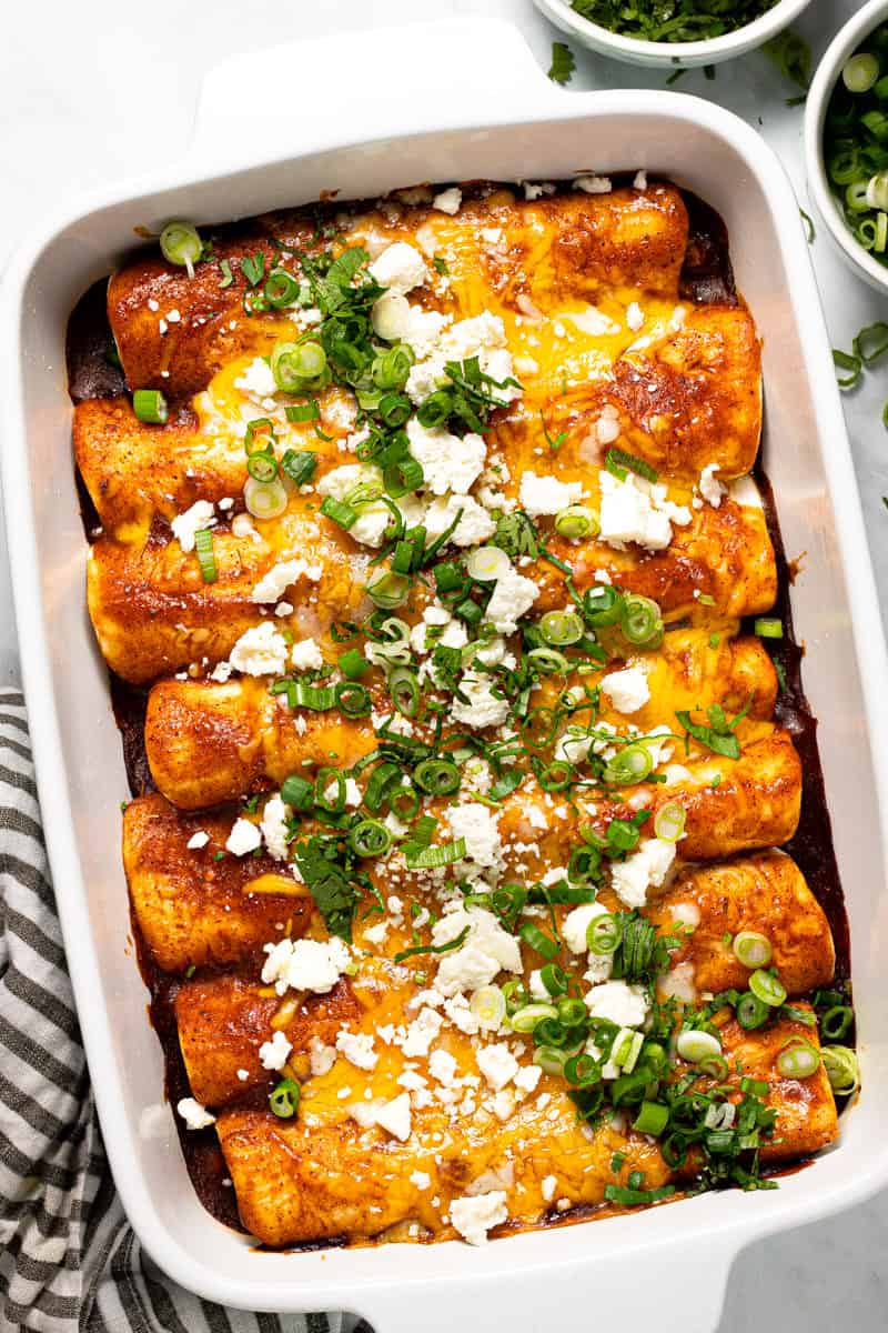 Large white baking dish filled with homemade black bean enchiladas