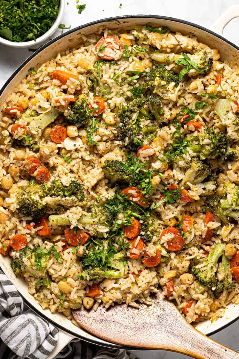 Large white pan filled with chickpeas and rice casserole with broccoli